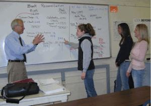 Dick Dumont working with students