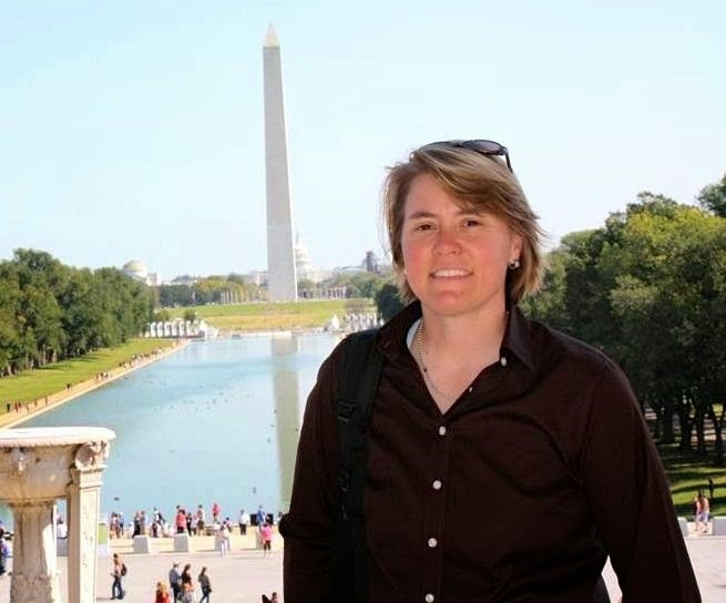 MPA graduate Celeste Robitaille in front of the Washington Monument