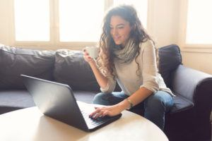 Woman searching for jobs on laptop