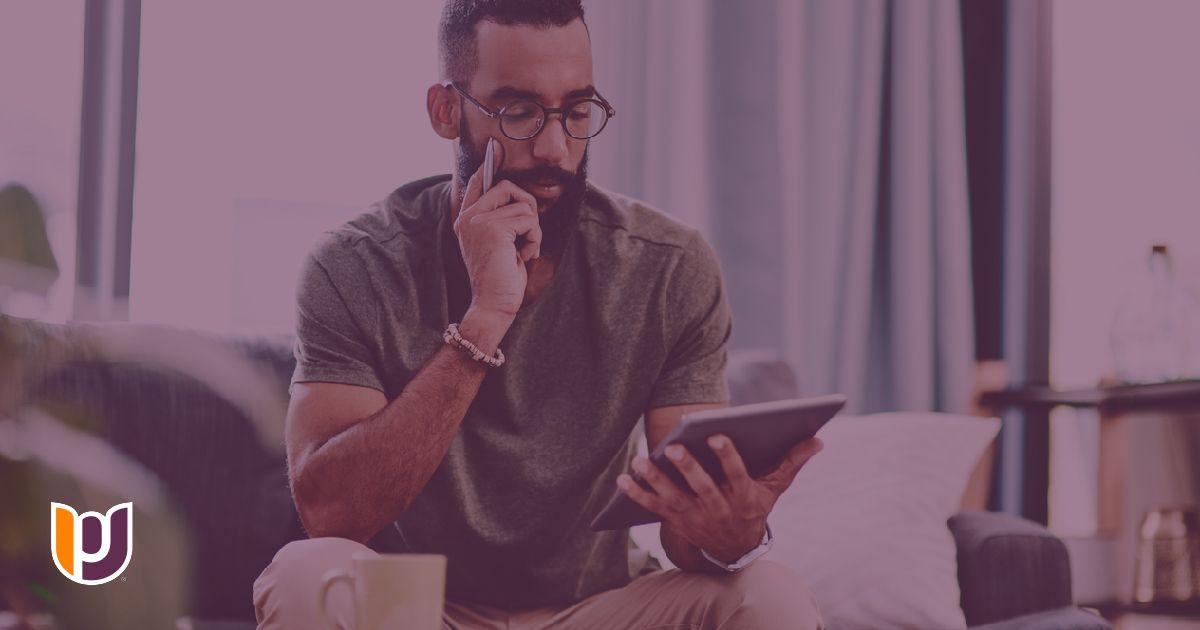 man reading from an ipad