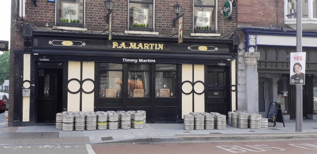 pub with beer kegs on the street