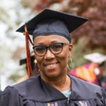 woman with cap and gown and glasses