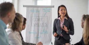 young Asian woman discussing core values with group