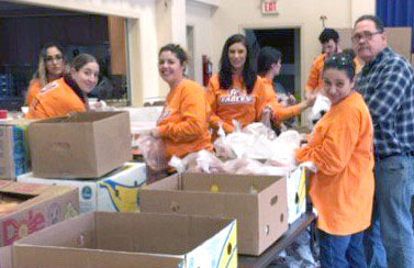 Post employees helping at food bank