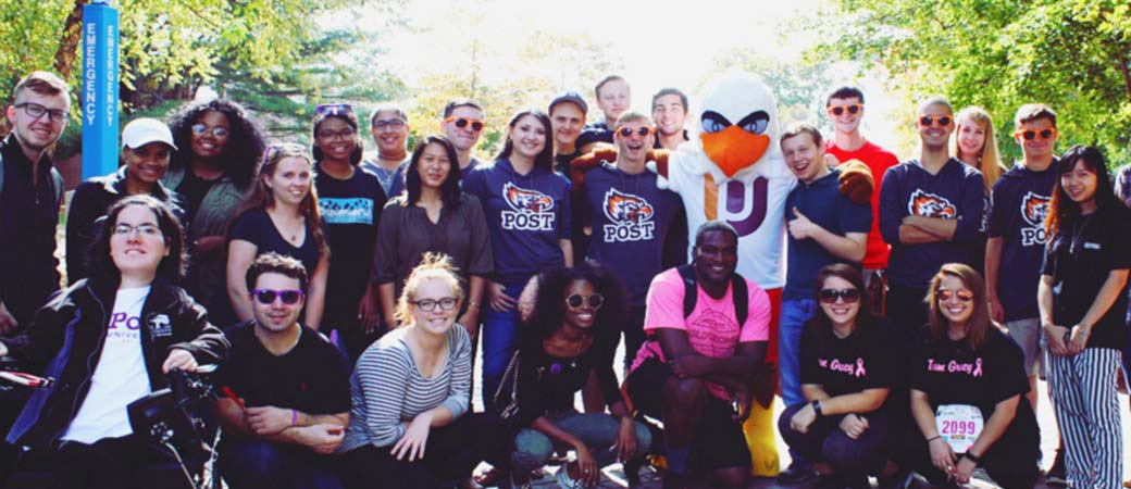 Group of students with the school mascot Swoop