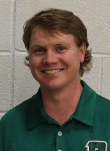 young man in green shirt smiling