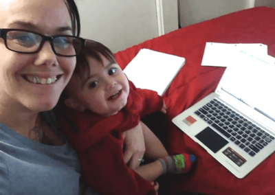 mother and child in front of computer