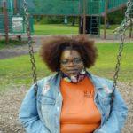 tina sitting on swing